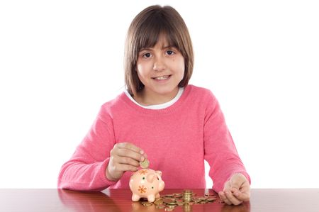 Adorable girl with money box a over white background photo