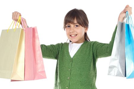Little girl with shopping bags a over white background Stock Photo - 2712491