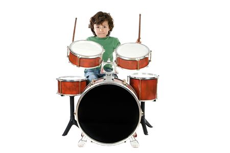 Child playing a drum  a over white background photo