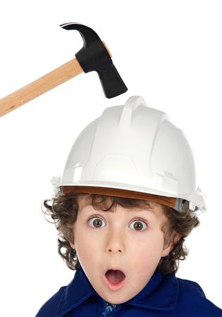 inspector kid: Small worker with a hammer and helmet on his head Stock Photo