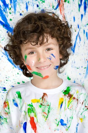 handsome boy: Handsome boy playing with painting with the background painted