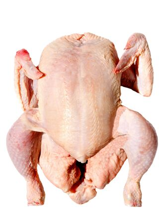 Photo of a raw chicken a over white background photo