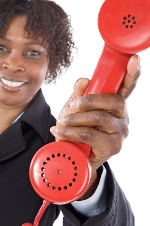Woman with a red phone a over white background photo
