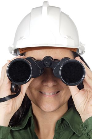 Attractive engineer woman looking through binoculars photo
