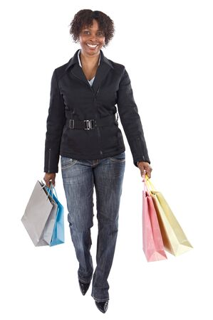 clothing stores: Attractive shopping girl a over white background Stock Photo