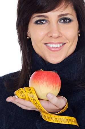 Woman whit apple and measuring tape a over white background photo
