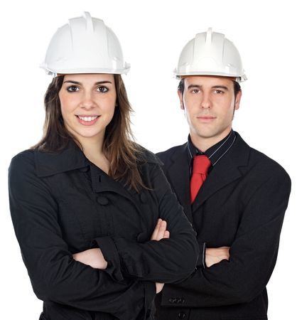 reviewing: Two young engineers a over white background