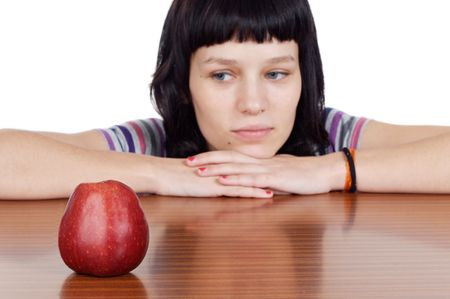 insipid: attractive girl with apple making a diet boring - focus in the apple - Stock Photo