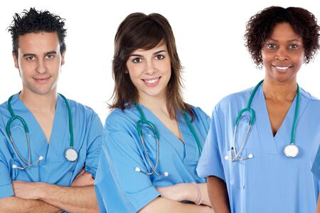 Team of young doctors a over white background