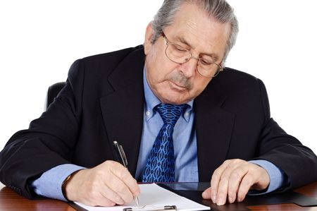 Senior businessman taking notes a over white background photo