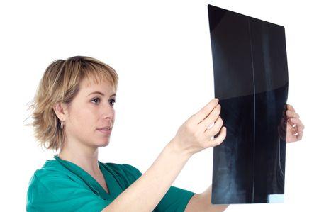 Woman medical professional analyzing a radiology photo