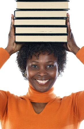 African american woman with books on her head photo