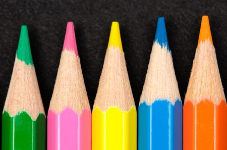 Color pencils - a over black background - photo