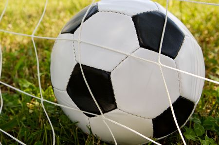 major: Photography of a Soccer ball in the goal net