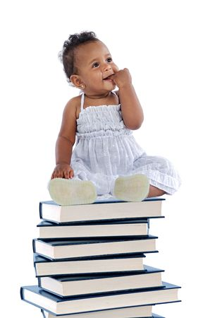 adorable baby on a book tower a over white background photo