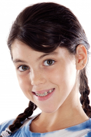 preteen girls: Adorable girl with braces a over white background