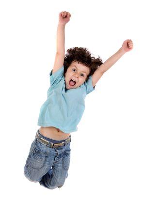 ni�os bailando: Adorable ni�o saltando sobre un fondo blanco Foto de archivo