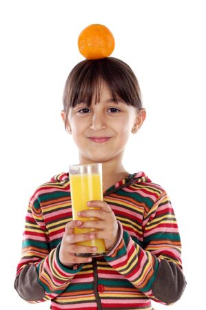 Girl drinking orange juice with orange on her head photo