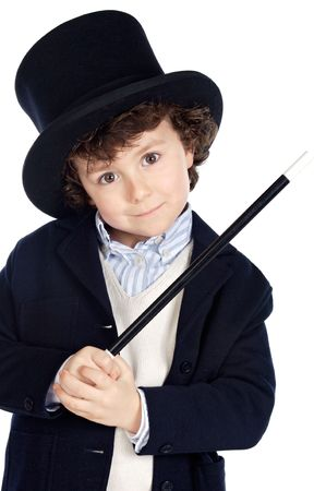 magic trick: Adorable child dress of illusionist with hat a over white background