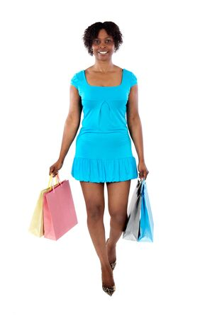 Attractive shopping girl a over white background photo
