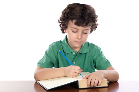 studding: adorable child write in book a over white background