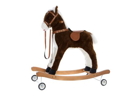 toy horse with a saddle and wheels Stock Photo