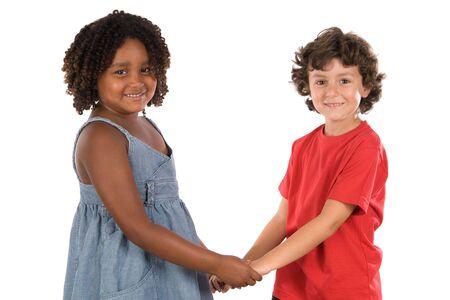 ni�os de diferentes razas: dos hermosos ni�os de diferentes razas con las manos juntas  Foto de archivo