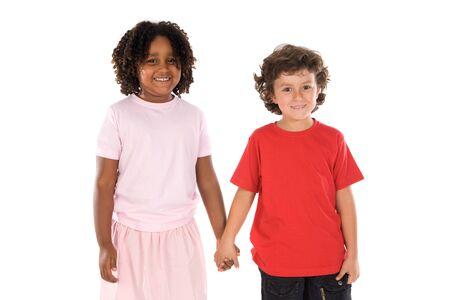 ni�os de diferentes razas: apuesto dos ni�os de diferentes razas con sus manos juntas