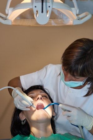 hygienist: consulting a dentist during a dental cleaning Stock Photo