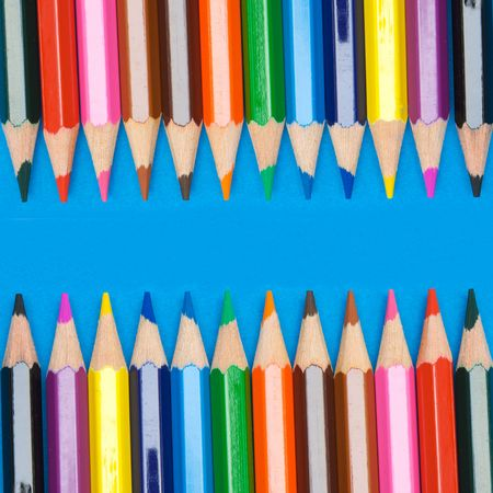 Pencils of many colors a over blue background photo