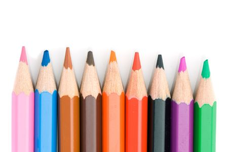 Colored pencils lined up on a white background photo