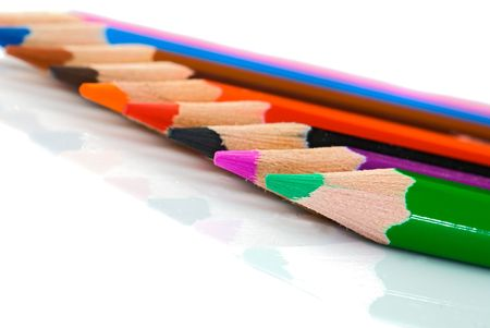Colored pencils lined up -Shallow depth of field photo