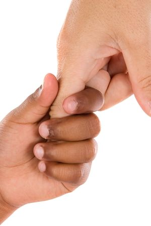 Two hands of different races together on a white background Stock Photo - 3498612