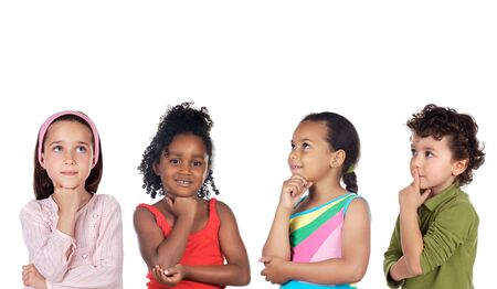 multiethnic group of children thinking a over white background photo