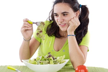 Young Girl eating salad. I do not like anything! photo