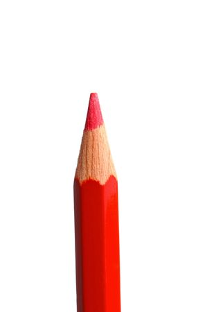 Red pencil in vertical on a white background photo
