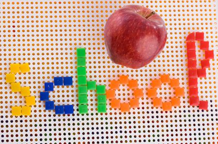 perforation: Back to school. Mosaic with the word school and a red apple