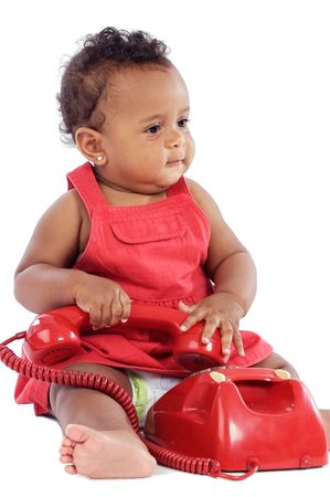 Baby with red phone a over white background photo
