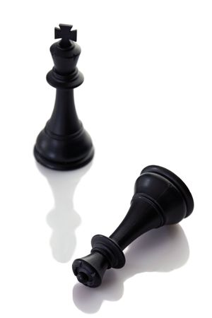 loss leader: The king wins the queen with focus on both - Shallow Depth of Field Stock Photo