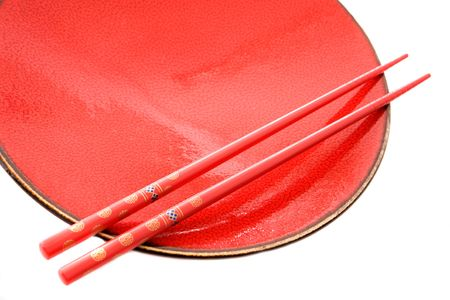 Red dish and chopsticks with oriental style on a white background Stock Photo - 3553717