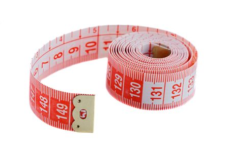 depth measurement: Tape rolled with Shallow Depth of Field a over white background