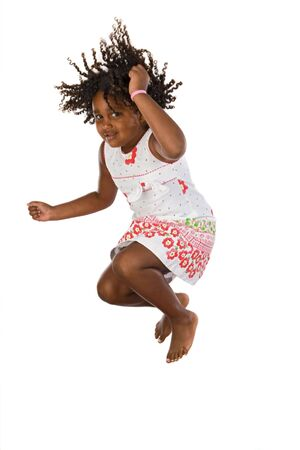 curly hair child: Adorable african girl jumping a over white background