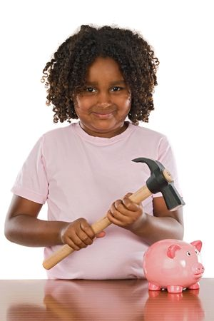 Happy girl with hammer and money box a over white background photo