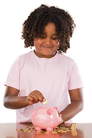 Adorable african girl putting a coin in a piggbank a over white background photo