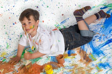 Boy playing with painting with the background painted photo