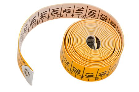 depth measurement: Tape rolled a over white background-Shallow Depth of Field-
