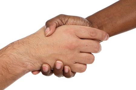 African and caucasian male shaking hands a over white background photo