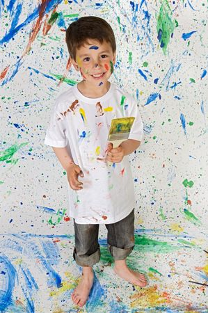boy barefoot: Little boy playing with painting with the  painted