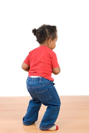 Adorable african dancing over wooden floor