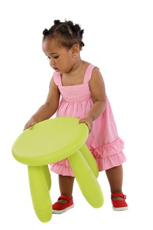 stool: African  catching the stool in the nursery